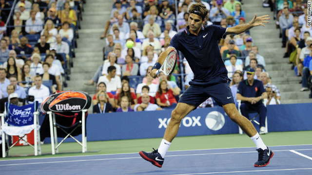Roger Federer returns a shot to Donald Young.