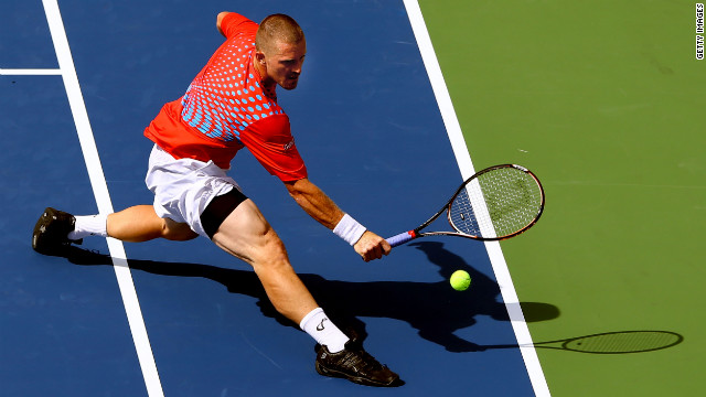 Russian Alex Bogomolov Jr. stretches to play a backhand against Andy Murray of Great Britain during their men's singles first-round match.
