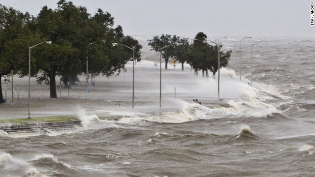 Isaac downgrades to a tropical storm as it continues to slam the gulf coast