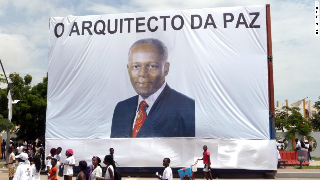 "Earlier this year, Angola celebrated 10 years of the end of its civil war. Here, Luanda residents walk in front of a giant portrait of President dos Santos, with text reading ""The Architect of Peace"" on April 4, 2012."
