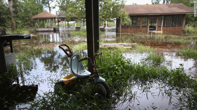 Water rises from a bayou, flooding properties ahead of the arrival of Hurricane Isaac in Bay St. Louis, Mississippi. 