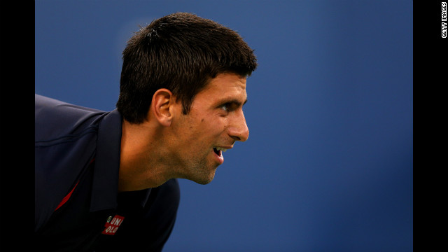 Serbian Novak Djokovic looks on against Italian Paolo Lorenzi during their men's single first-round match.