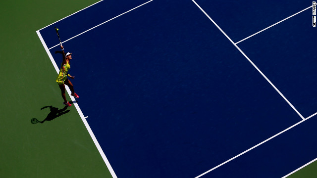 Serbia's Ana Ivanovic serves to Ukraine's Elina Svitolina during their women's singles first-round match.