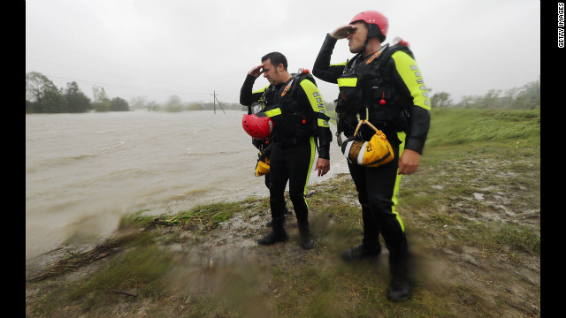 Rescue workers survey the floodwaters from a levee in Braithwaite. 