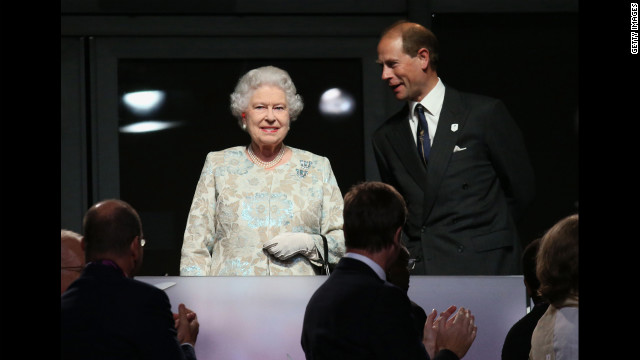 Attendees applaud Queen Elizabeth II and her son Prince Edward, Earl of Wessex.