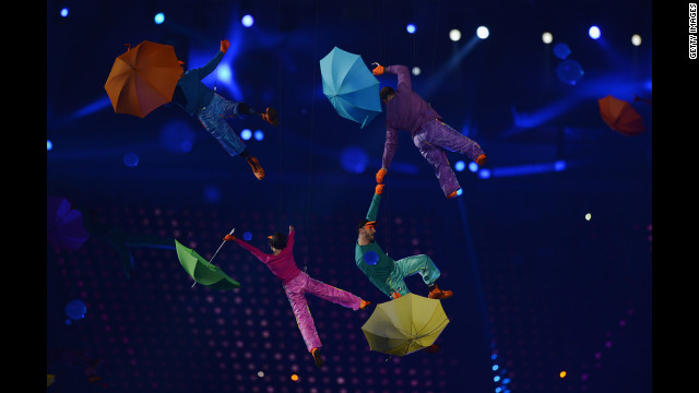 Artists perform with colorful umbrellas during the opening ceremony.