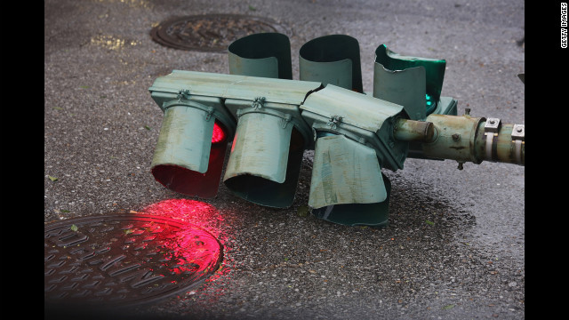 A traffic light continues to glow after being downed by Isaac's winds.