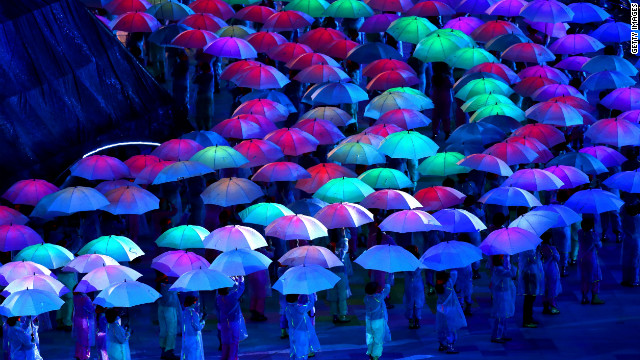 Artists perform with umbrellas.