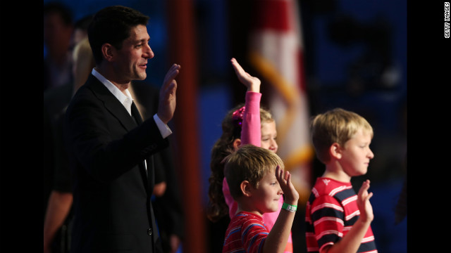 Ryan waves with daughter, Liza Ryan, and sons, Charlie Ryan, right, and Sam Ryan from the stage during a soundcheck.