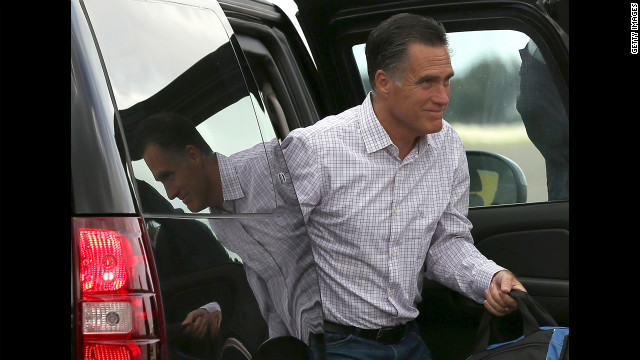 Republican presidential candidate Mitt Romney exits a vehicle before boarding his campaign plane. As the Republican National Convention continues, Romney will travel to Indianapolis to address the American Legion.
