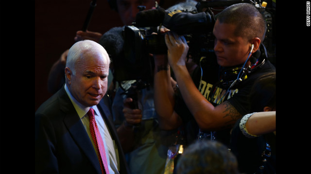 Arizona Sen. John McCain walks the floor.