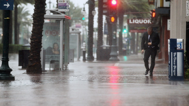 A man walks on Canal Street in New Orleans.