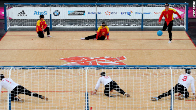 China, top, and Iran compete in the men's group B goalball match Thursday.