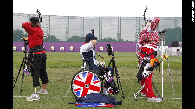 Britain's Mel Clarke, center, competes in the women's archery individual compound open ranking round.