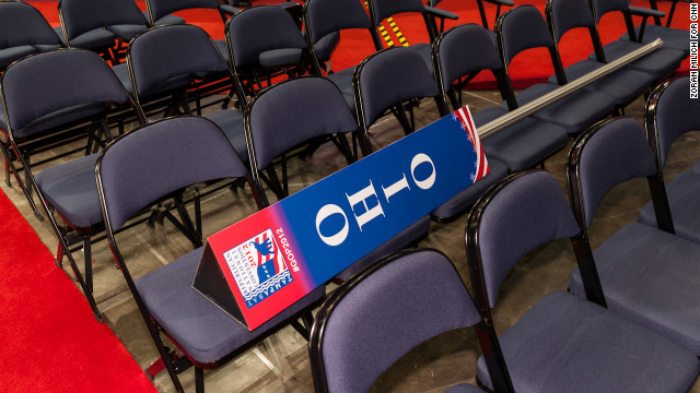 A sign marking the Ohio delegation sits on empty seats on the floor of the convention hall.