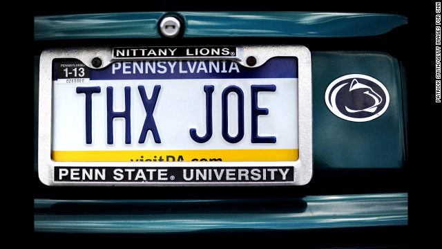 A car parked in a garage on campus has a license plate message directed at the former Penn State football coach.