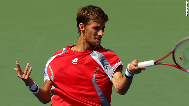 Martin Klizan of Slovakia powers a return during his four-set win over Jo-Wilfried Tsonga at the U.S. Open.