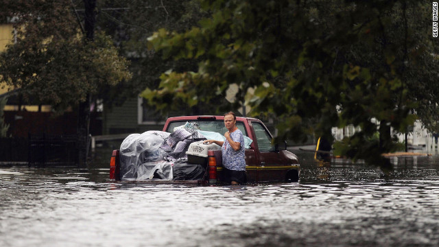 A woman is stranded with her truck in floodwaters from Isaac on the north shore of Lake Pontchartrain on Thursday in Slidell, Louisiana.