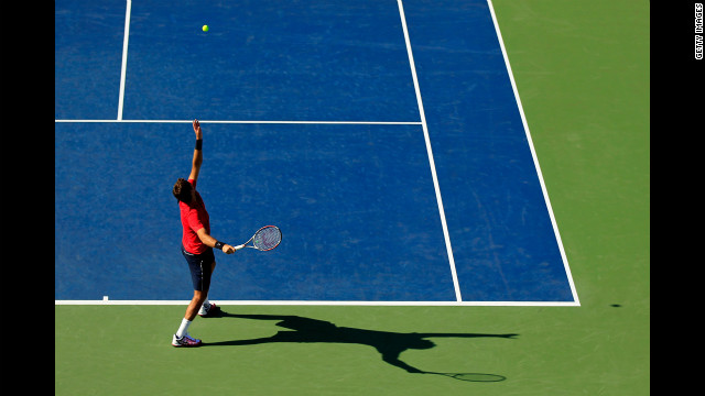 Juan Martin Del Potro of Argentina serves against Florent Serra of France.