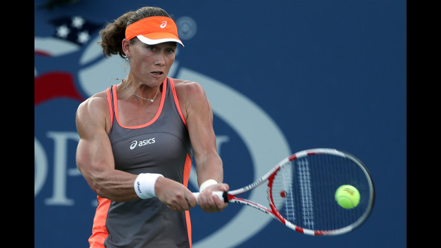 Australian Samantha Stosur returns a shot during her women's singles second-round match against Romanian Edina Gallovits-Hall.