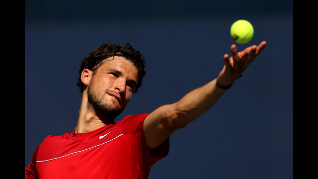 Bulgaria's Grigor Dimitrov serves to France's Benoit Paire.