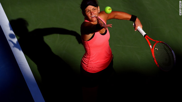 Australian Casey Dellacqua serves against China's Na Li during their second-round match.