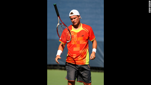 Australian Lleyton Hewitt tosses his racquet during his men's singles first-round match against German Tobias Kamke.