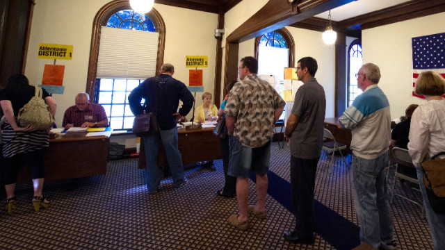 Voters enter the polling station at City Hall in Hudson, Wisconsin, in June in the vote on whether to recall Gov. Scott Walker.