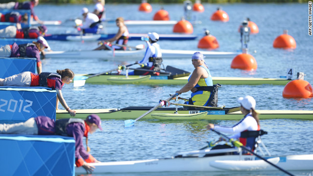 Ukraine's Alla Lysenko (second in row) prepares to take part in the women single sculls heat on Friday.