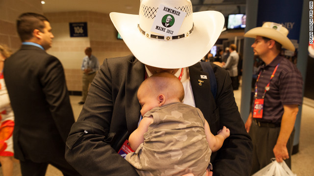 Texas delegate Read King kisses his son Benjamin on Thursday.