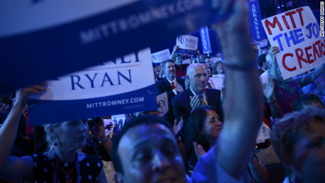Delegates wave signs on the final day of the RNC.