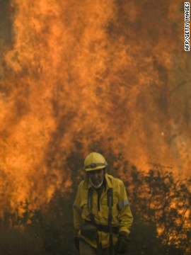 A firefighter walks on the site of a wildfire in Ojen on August 31, 2012.
