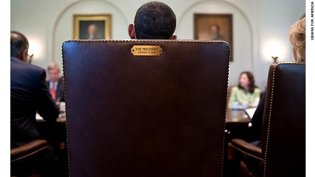 Obama takes his seat