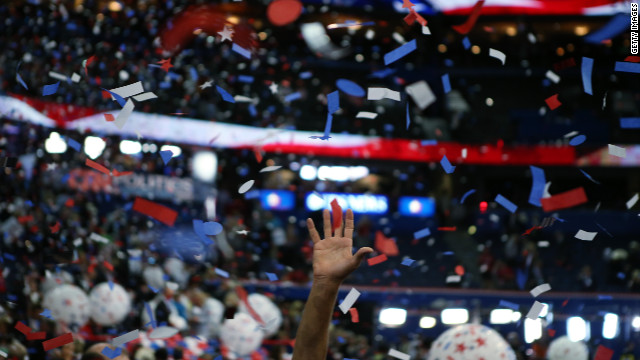 Attendees celebrate as confetti and balloons drop after Romney's speech.