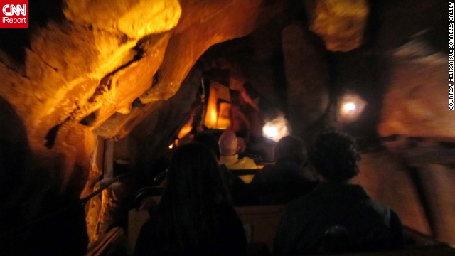 "Melissa Sue Sorrells Galley <a href='http://ireport.cnn.com/docs/DOC-832099'>took this shot on Big Thunder Mountain Railroad</a> at Walt Disney World in Orlando, Florida. ""It's really amazing at night because the caves are eerily dark, and then you come out of the caves and up over a hill and you can see Cinderella Castle in all of its colorful nighttime glory."""