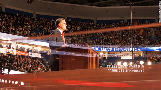 A reflection of the National Debt Clock is seen as Mitt Romney speaks on the last night of the convention.