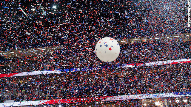 Balloons and confetti drop after Romney's speech.
