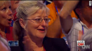 An unidentified woman tears up as Mitt Romney speaks about his parents during Thursday night\'s speech.