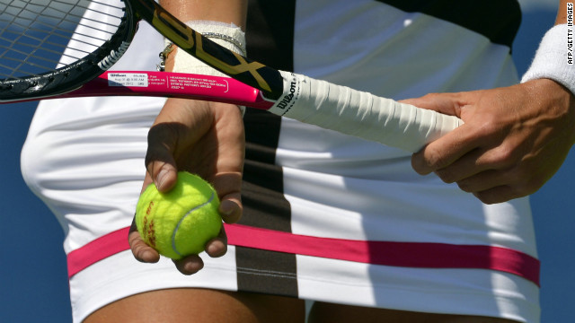Varvara Lepchenko of the United States returns against Samantha Stosur of Australia.