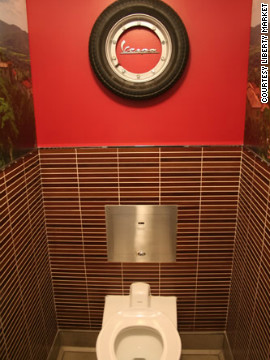 At this former grocery store turned stylish bistro in Gilbert, Arizona, each of the five unisex restroom stalls features a distinctive design and a coordinating playlist. Punk rock is played in this little ode to a roadhouse.