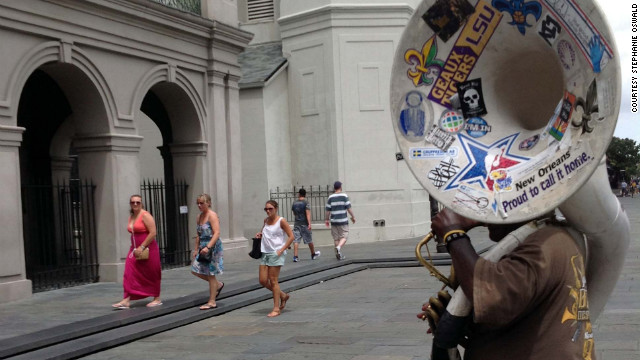 Musicians and tourists mingled in front of the Saint Louis Cathedral on Jackson Square Friday, two days after Isaac arrived in the city.