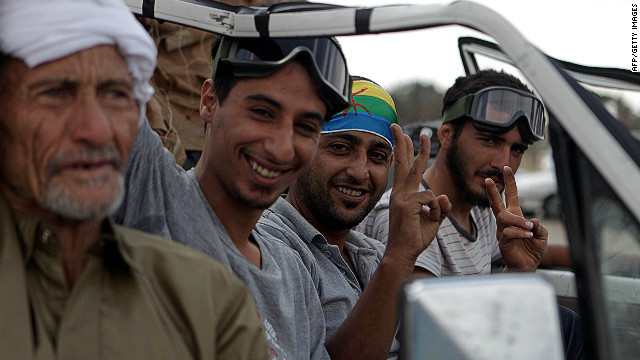 Berber rebels flash victory signs outside a Gadhafi compound in September 2011. Berbers fought