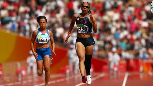 U.S. athlete April Holmes competes in the women's 100m T44 event on day eight of the 2008 Paralympic