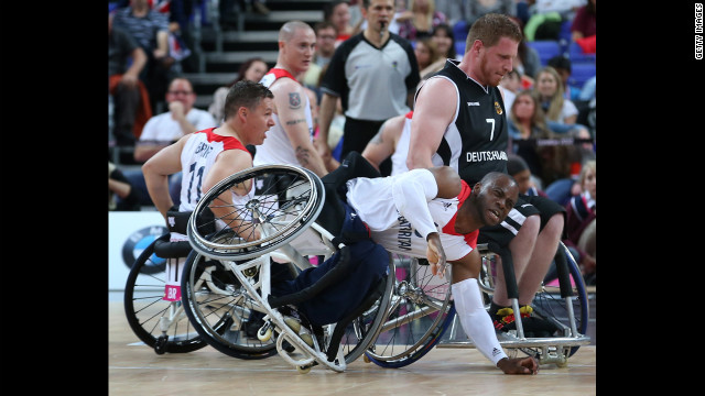 Great Britain's Ade Oregbemi takes a tumble in the preliminary men's wheelchair basketball match, which Germany won 77-72, on Thursday, August 30.