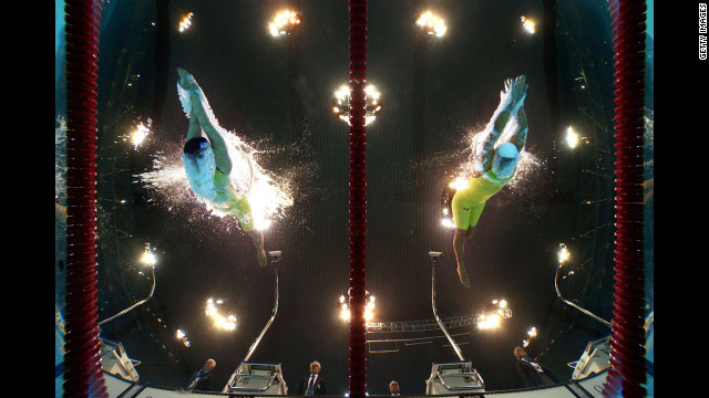 The United States' Jessica Long, left, and Ukraine's Kateryna Istomina compete in the women's 100-meter butterfly.