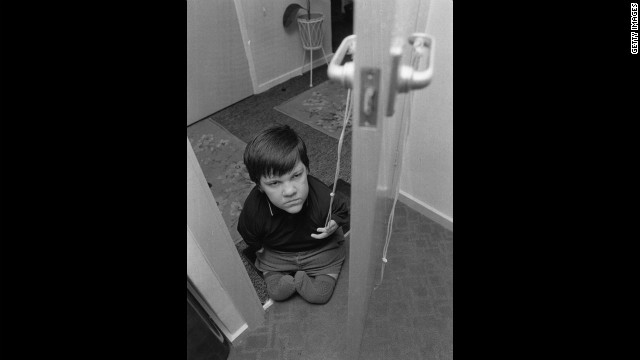 Eddie Freeman, 13, opens a door with a piece of string in this 1973 image.