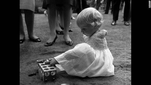 Phillipa Bradbourne uses her feet to play with a toy.