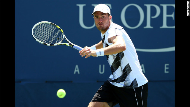 American Steve Johnson returns a shot against Latvian Ernests Gulbis.