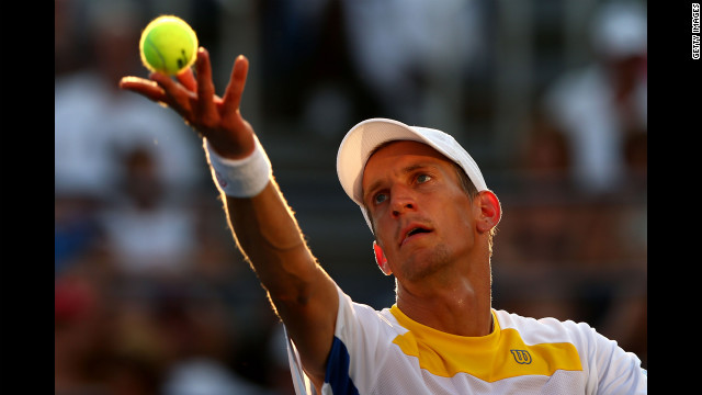 Jarkko Nieminen of Finland serves against John Isner of the United States.