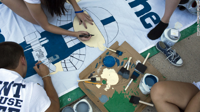 Penn State students work on a banner at &quot;Nittanyville&quot; outside Beaver Stadium in State College, Pennsylvania, on Friday, August 31.